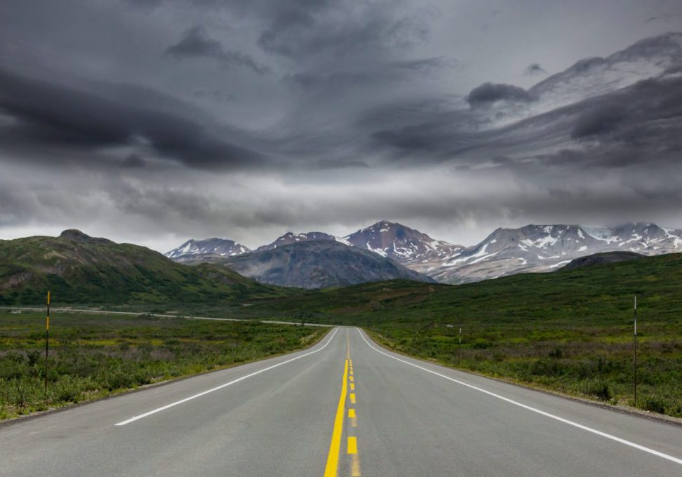 Scenic highway in Alaska, USA. Dramatic view storm clouds